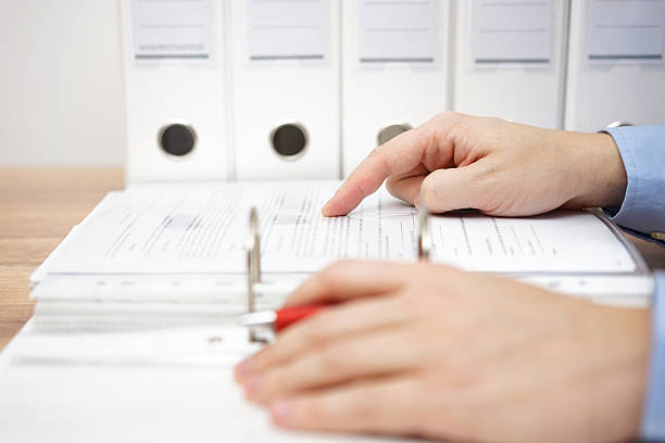 attorney is examining business documentation stock photo