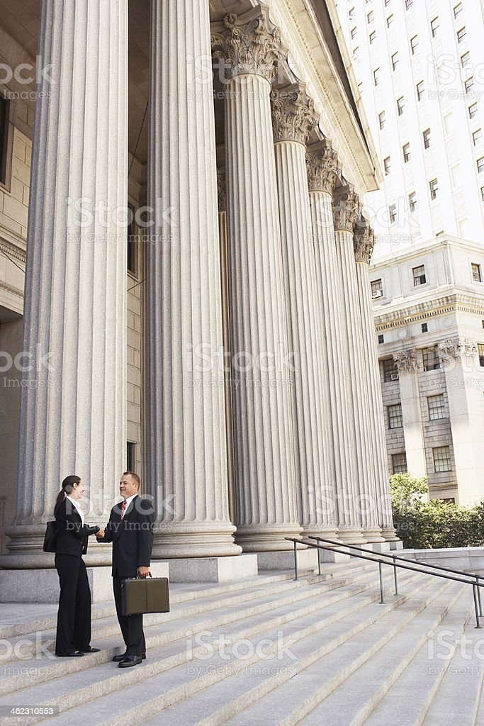 Attorneys Shaking Hands On Courthouse Steps stock photo