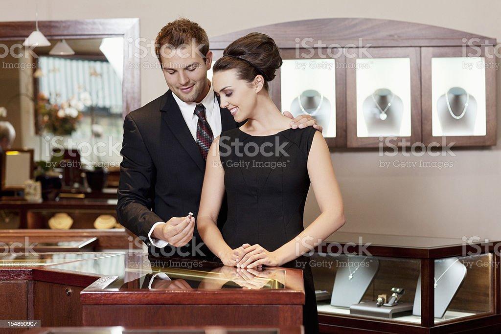 Attracitve Young Couple Admiring Diamond Wedding Rings stock photo