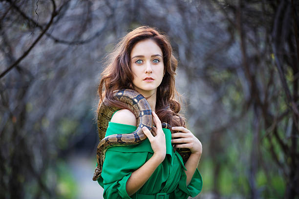 Attracrive girl with snake