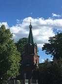 Attractions of the city of Jõhvi Estonia, against the background of a bright blue sky with clouds