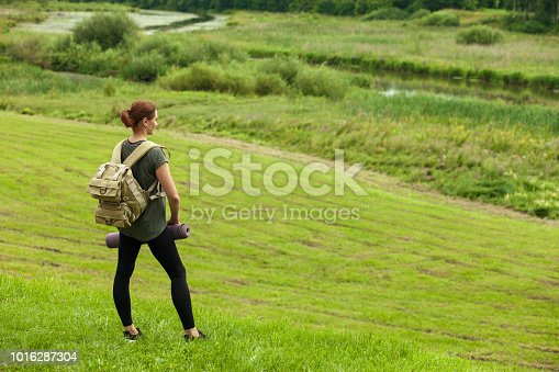 attractive 30 year old woman on a walk in the forest