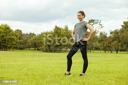 Attractive 35 year old woman doing yoga in a public park