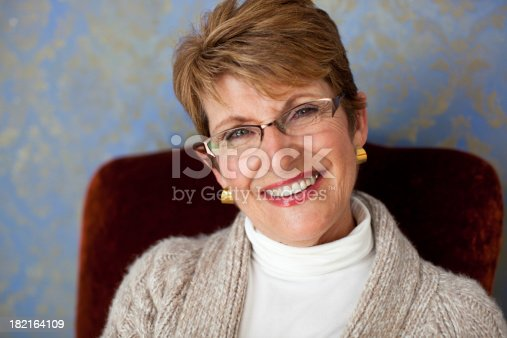 attractive 60 year old woman smiling at the camera