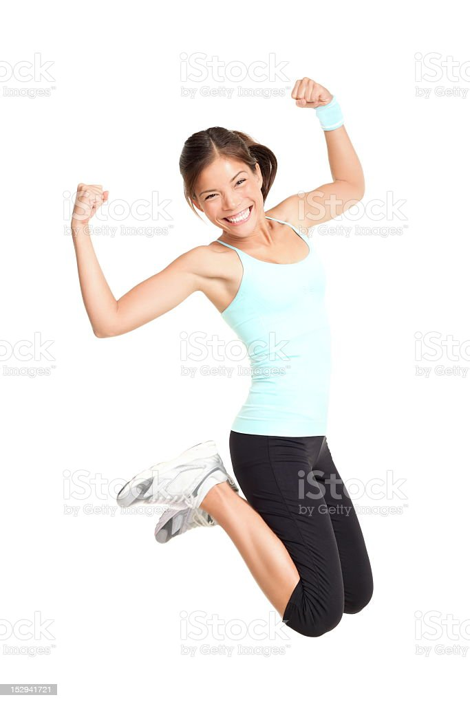 Attractive active woman jumping stock photo