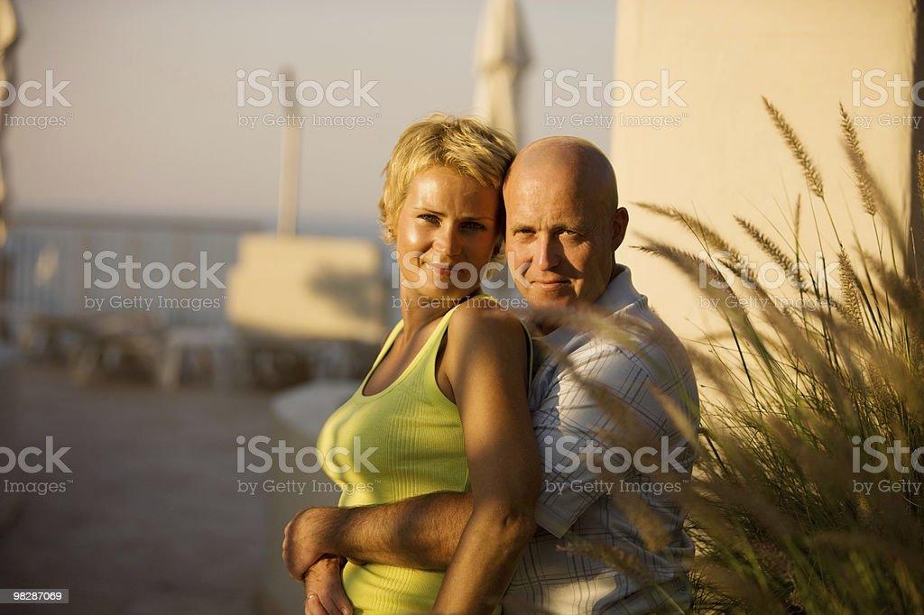 Attractive Adult couple enjoying sunset royalty-free stock photo
