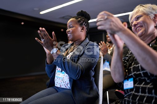 505413934 istock photo Attractive African American businesswoman encouraging speaker at professional convention presentation with diverse crowd of colleagues 1178183503