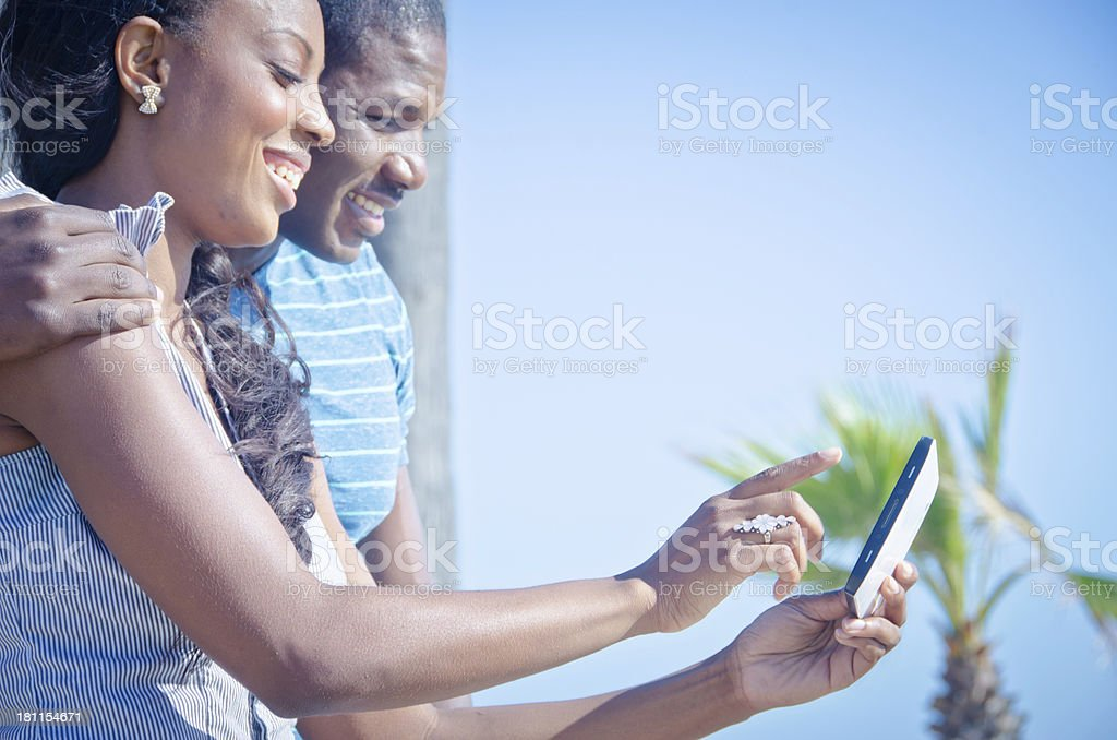 Attractive African American Couple Looking at Tablet royalty-free stock photo