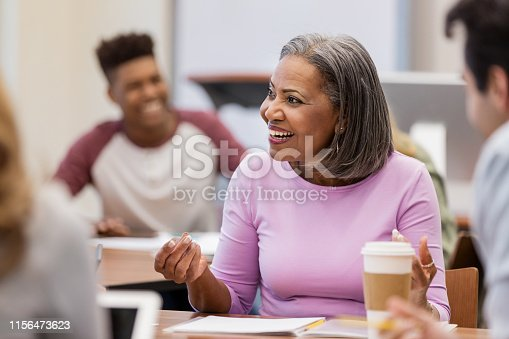 istock Attractive African American woman explains her position 1156473623