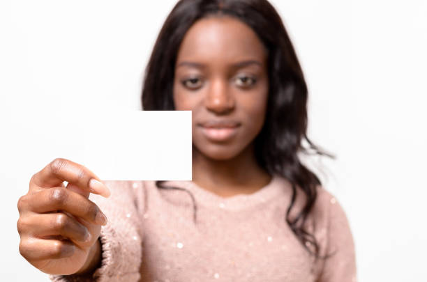 royalty free african woman holding a blank business card pictures