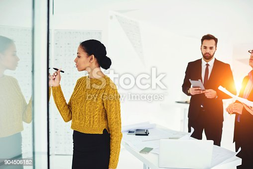 Attractive afro american female secretary assistant writing on board plan of conference meeting include important themes must be discussed during formal meeting with professional traders partners