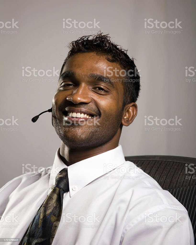 attractive and happy trendy young businessman talks royalty-free stock photo