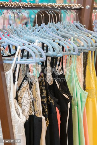 Attractive and seductive lingerie on a hanger in a women's clothing store. Women's lace lingerie on a hanger in the store. Sexuality and attractiveness. vertical photo.