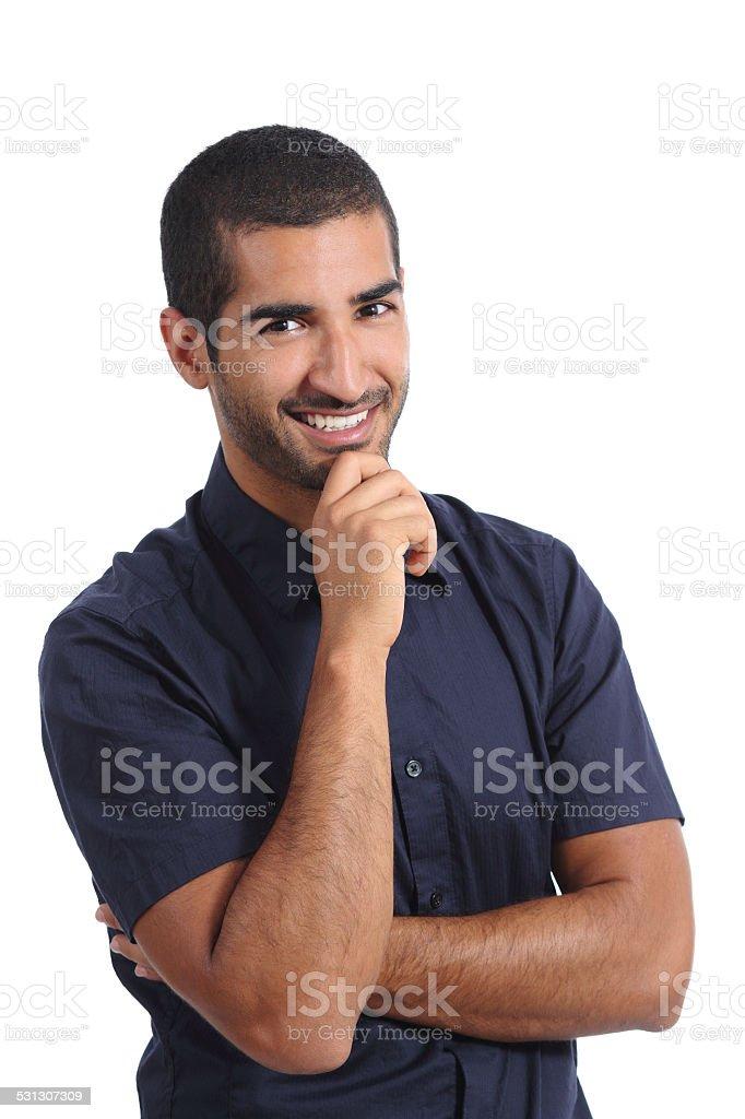 Attractive arab pensive man thinking and looking at camera stock photo