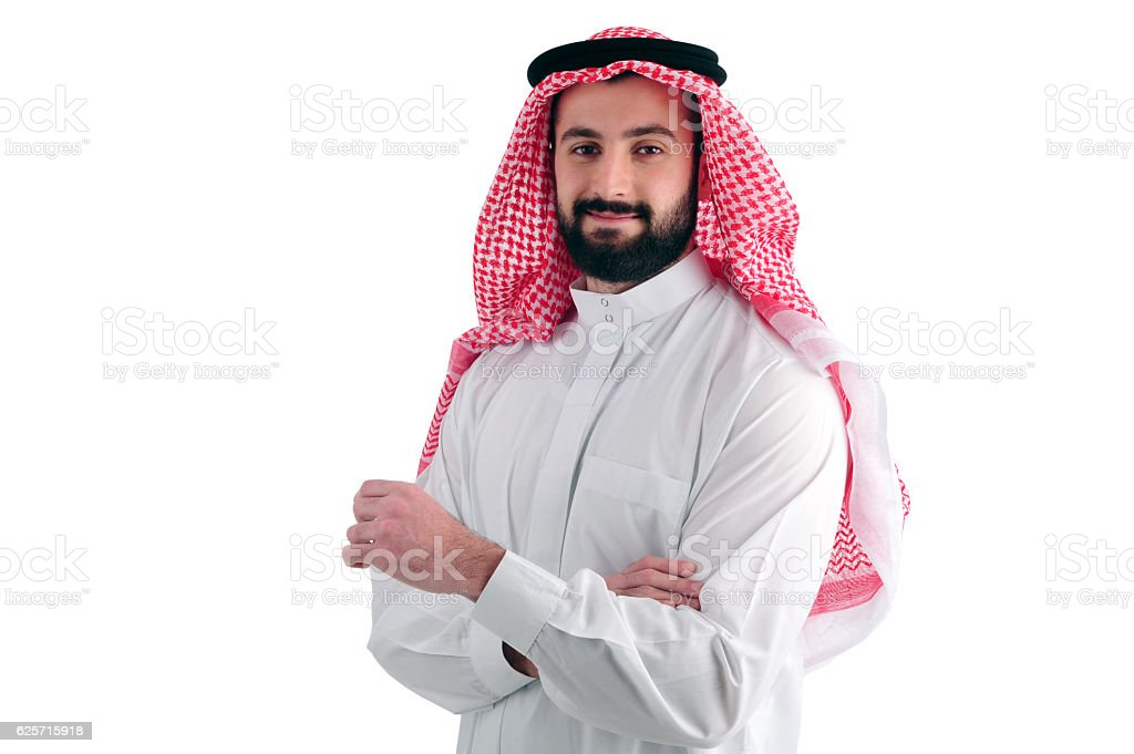 Attractive Arabian Business Man standing over a white background stock photo