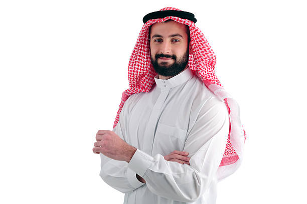 Attractive Arabian Business Man standing over a white background - Photo