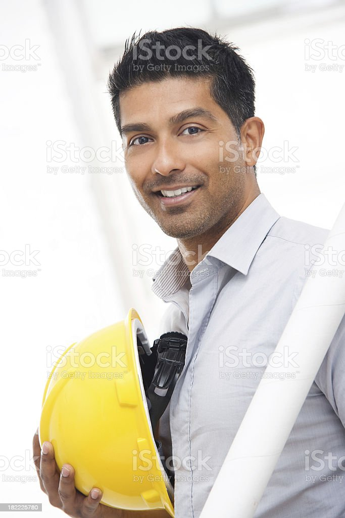 Attractive Architect or Engineer Holding Construction Hat royalty-free stock photo