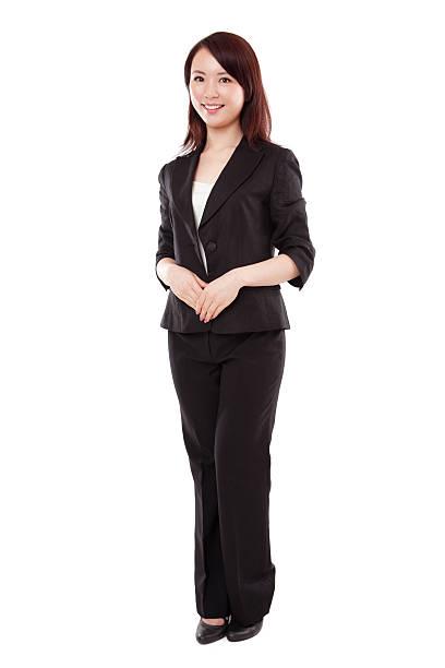 魅力的なアジアのビジネスウーマンのスーツに白背景 - 全身 ストックフォトと画像