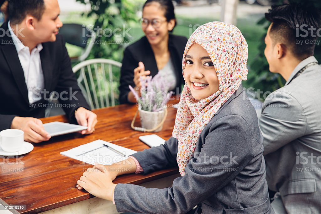 Attractive asian businesswoman smiling at the camera stock photo