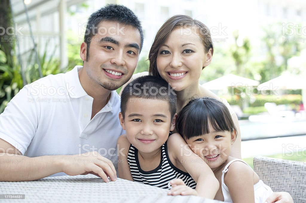 Attractive asian family in a resort royalty-free stock photo