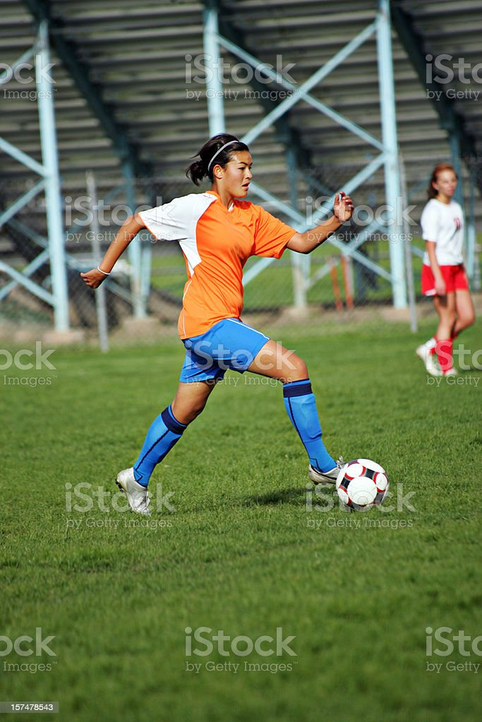 Attractive Asian Female Soccer Player with Sprint Touch on Ball stock photo