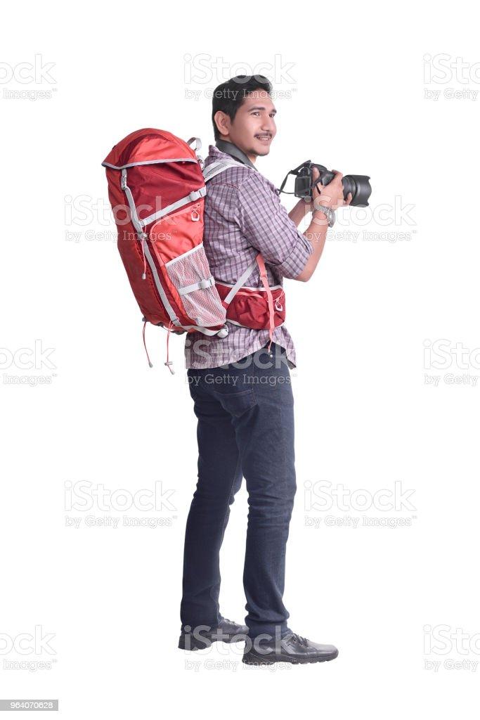 バックパックとカメラで魅力的なアジア旅行 - 1人のロイヤリティフリーストックフォト