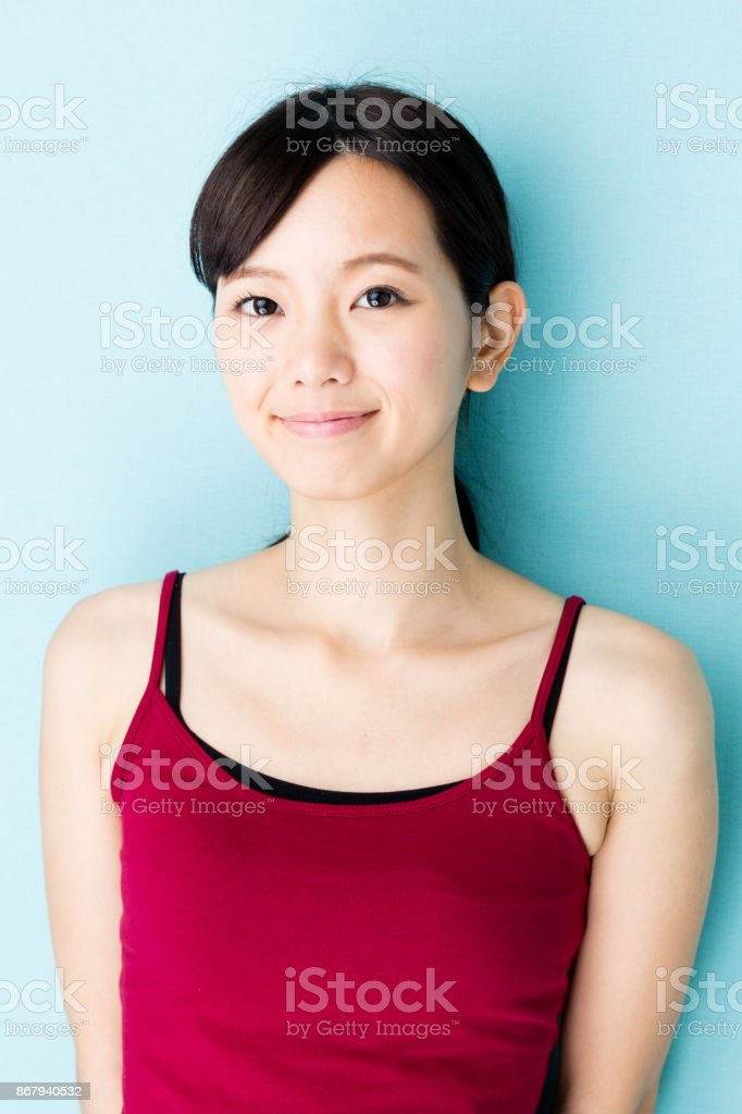 attractive asian woman beauty image isolated on blue background stock photo