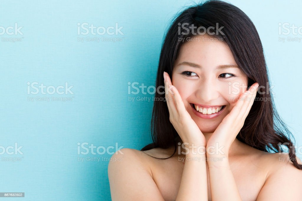 attractive asian woman beauty image on blue background stock photo