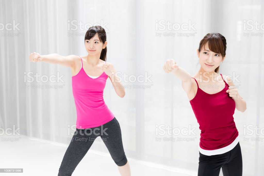 attractive asian woman exersicing stock photo