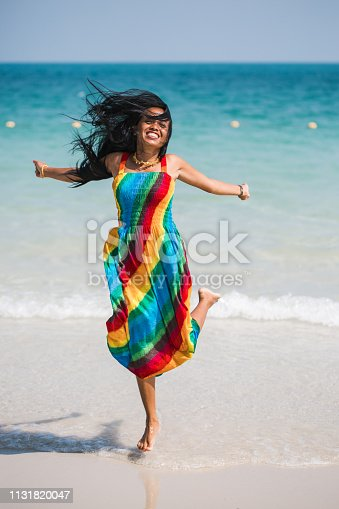 istock Attractive asian woman is jumping at the beach in Thailand 1131820047