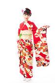 attractive asian woman wearing furisode isolated on white background