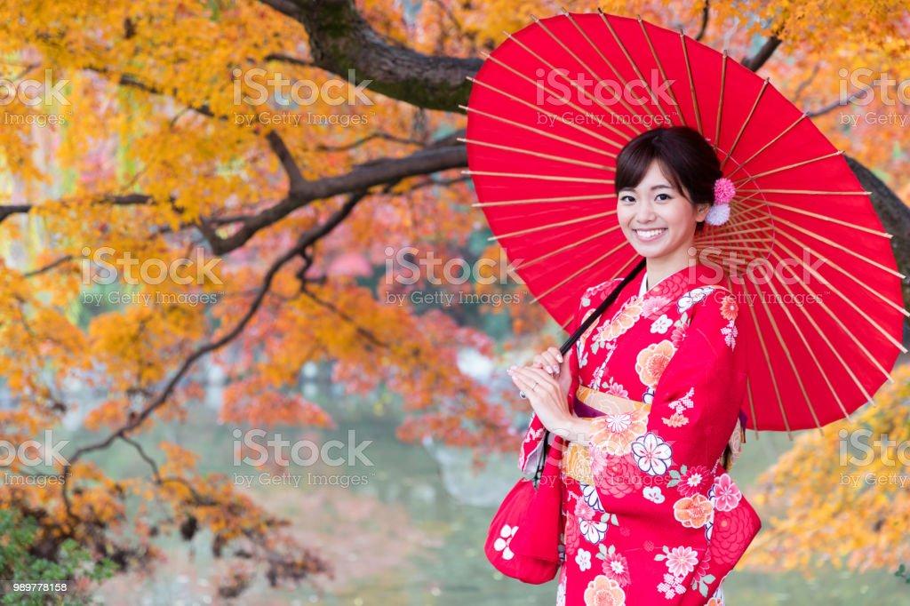 57745a1a622e7 Attractive Asian Woman Wearing Kimono In Autumn Stock Photo   More ...