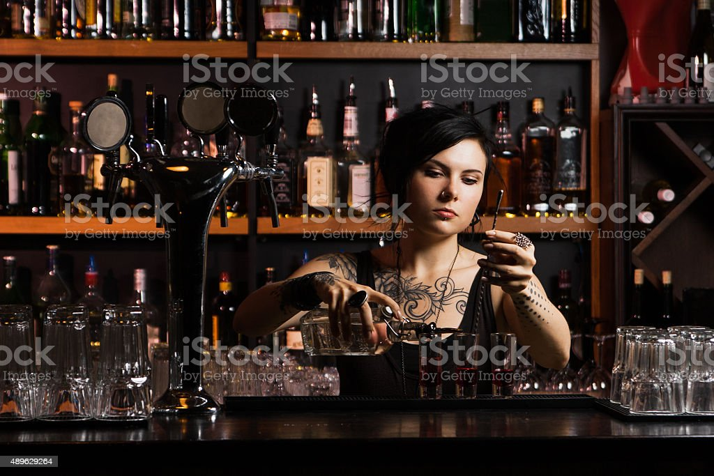Attractive bartender stock photo