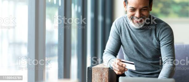 Attractive bearded hipster asian father or hispanic old man using picture id1159543764?b=1&k=6&m=1159543764&s=612x612&h=sgombn25uwkc2me6fvqzxkcky4dlpdyz284i3fmzd4k=