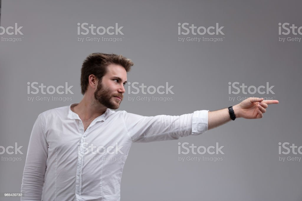 Attractive bearded man pointing to the side zbiór zdjęć royalty-free