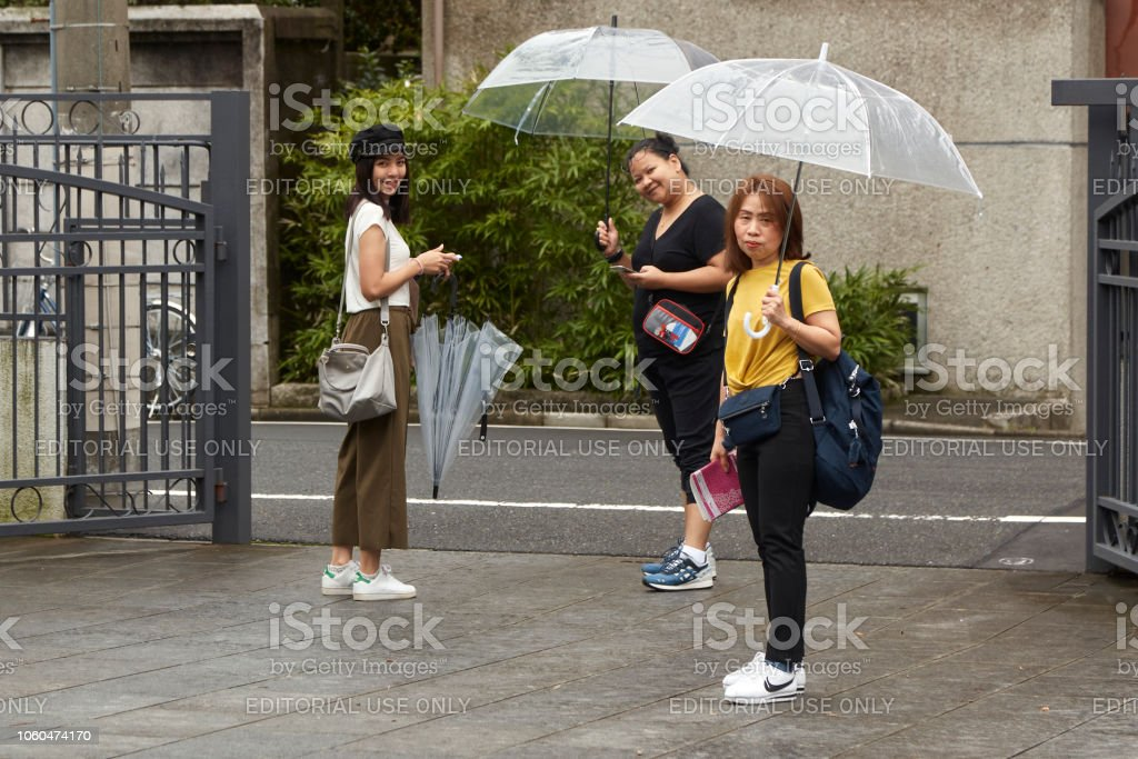 Beautiful young woman. Attractive beautiful lady hold an umbrella....