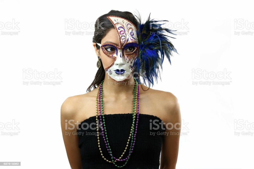 Attractive beautiful young woman wearing masquerade mask stock photo