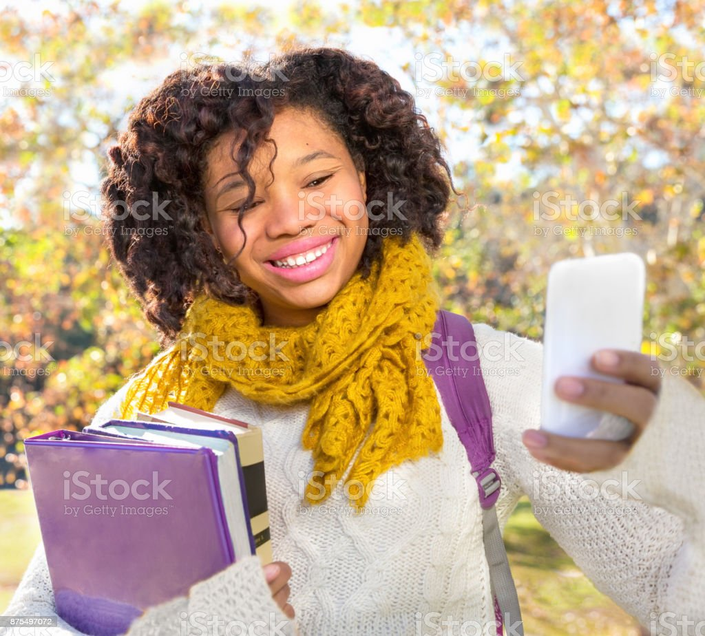 Attractive Black African American Student Taking Selfie stock photo