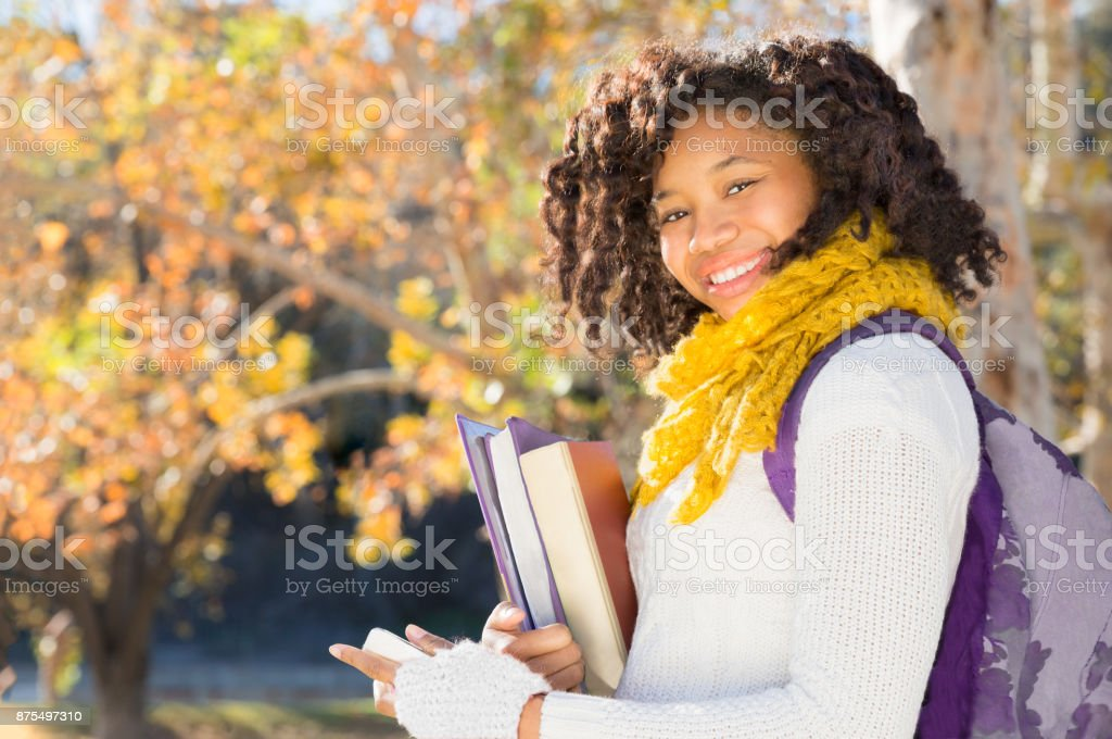 Attractive Black African American Student with Phone stock photo