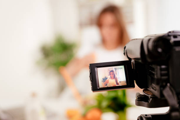 Attractive Blogger Girl Making Video For You stock photo