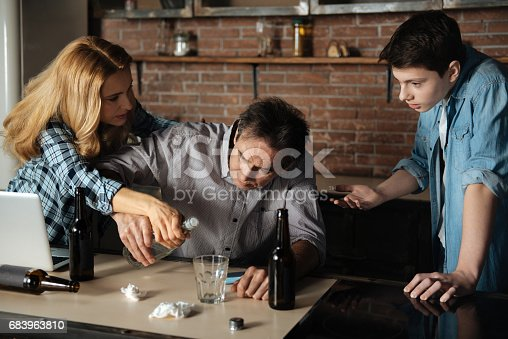 istock Attractive blond female taking away the bottle 683963810