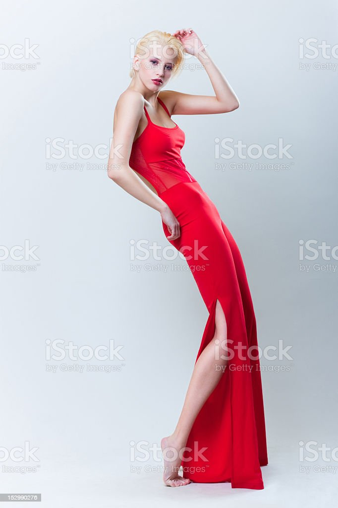 attractive blond girl in red dress royalty-free stock photo