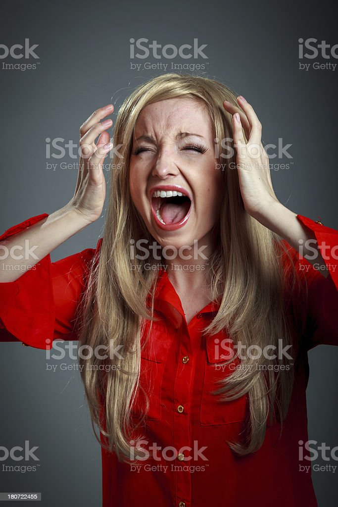 Attractive blond girl in red shirt royalty-free stock photo
