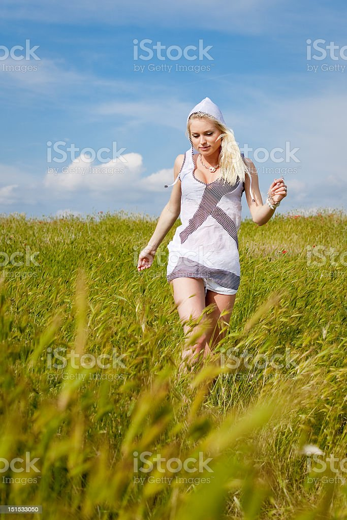 Attractive blond girl on field royalty-free stock photo