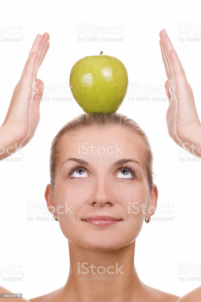 Attractive blond girl with an apple on her head royalty-free stock photo