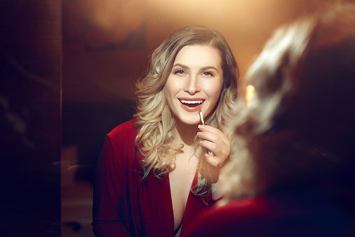 109721176 istock photo attractive blond hair woman in the mirror 544660516