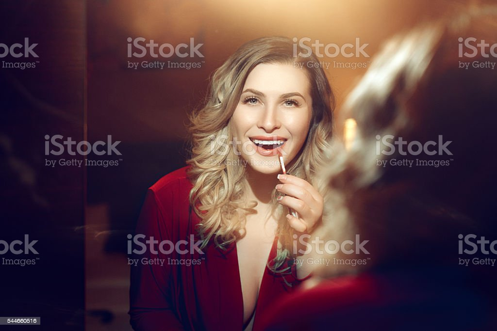 attractive blond hair woman in the mirror stock photo