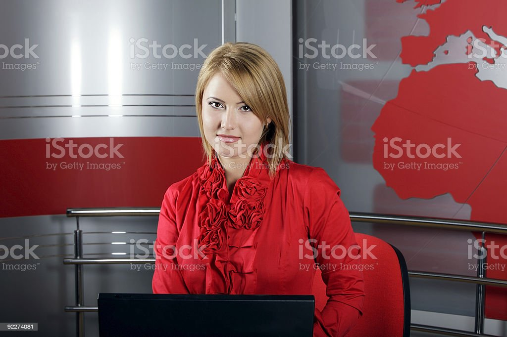 attractive blond presenting news reports royalty-free stock photo