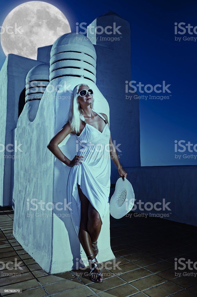Attractive blond woman at midnight outdoors royalty-free stock photo