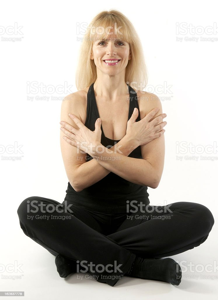 Attractive blond woman doing yoga stretching exercise royalty-free stock photo